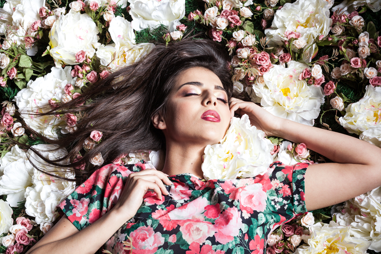 woman lying down on flowers